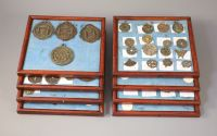 A group of 99 Korean bronze and metal amulets or charms, 19th/20th century