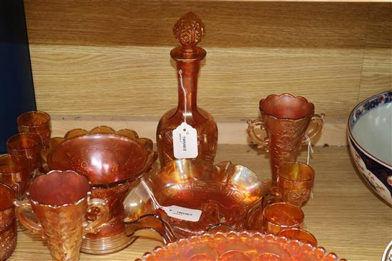 A pair of Carnival glass crucifix candlesticks and a collection of other marigold Carnival glass,