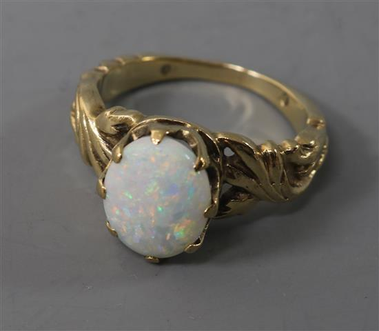 A 9ct? gold and white opal dress ring, size I.