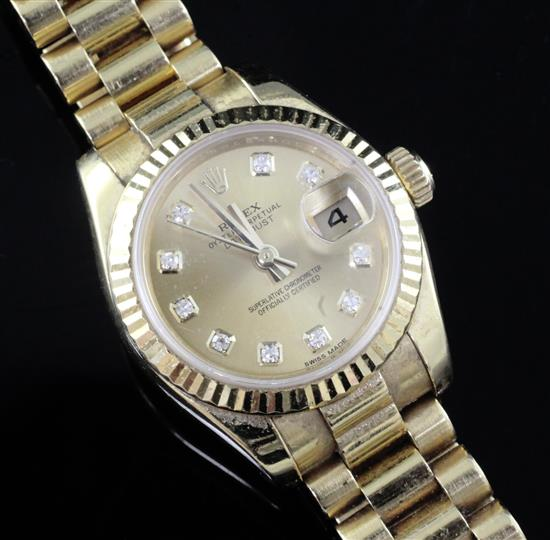 A ladys modern 18ct gold and diamond set Rolex Oyster Perpetual Datejust wrist watch,