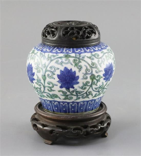 A rare Chinese doucai lotus flower jar, Wanli six character mark and probably of the period, (1573-1619), H. 9.5cm, D. 10.8cm, later
