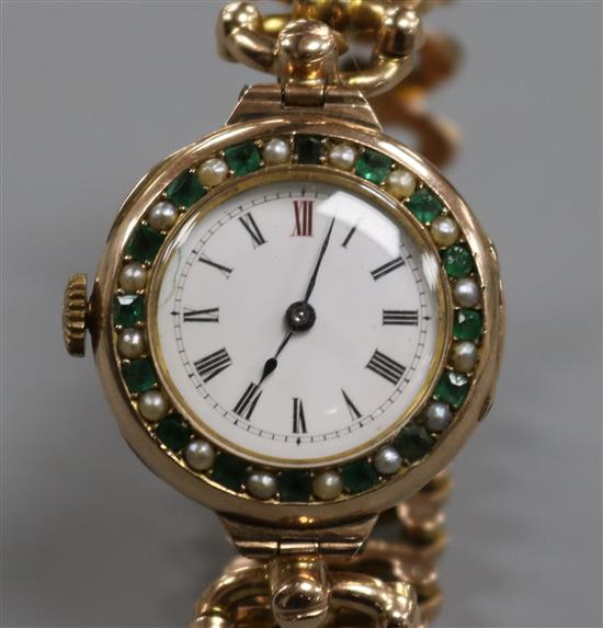 An early 20th century 9ct gold gem set manual wind wrist watch on a 9ct gold expanding bracelet.