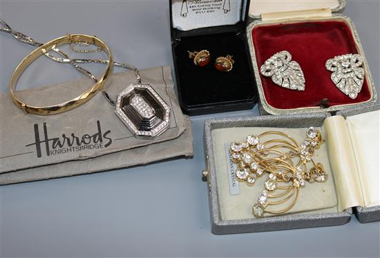 A Butler and Wilson bracelet from Harrods and other items of costume jewellery.