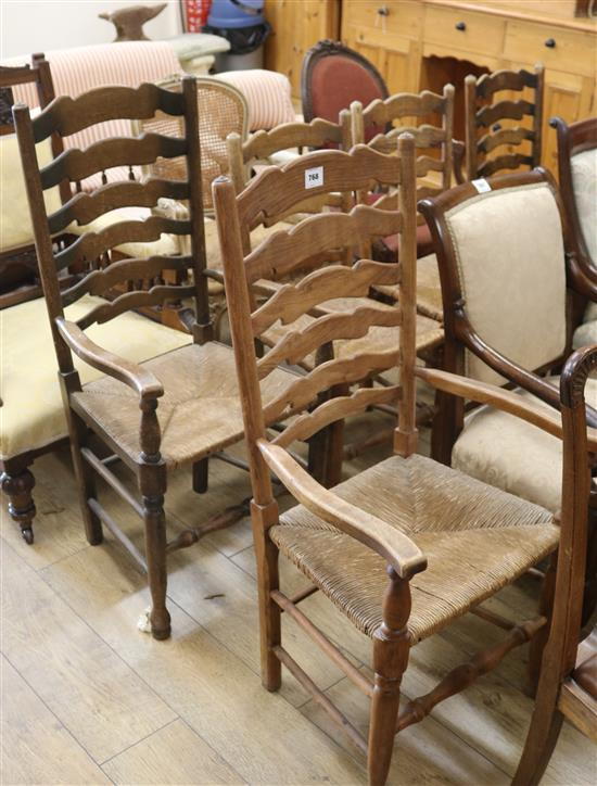 A set of five ash ladderback, rush seated dining chairs