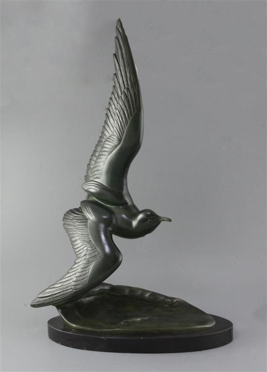 Irénée Rochard (1906-1984). A French Art Deco green patinated bronze model of a seagull flying over a wave, height 28in.