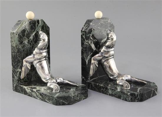 Maurice Frecourt. A pair of Art Deco silvered spelter marble and ivory bookends, 7.5in.