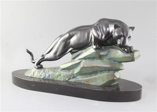 M. LeDucq. An Art Deco patinated spelter model of a panther upon a rock, 23in.