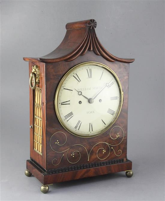 An early 19th century brass inlaid mahogany table clock and wall bracket