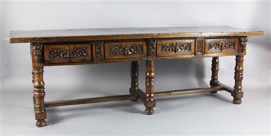 A mid 17th century Italian walnut table, L.8ft 7.5in.