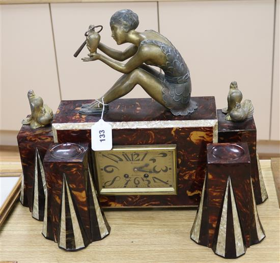 A 1930s faux tortoiseshell and faux mother-of-pearl spelter mounted figural clock garniture clock height 41cm