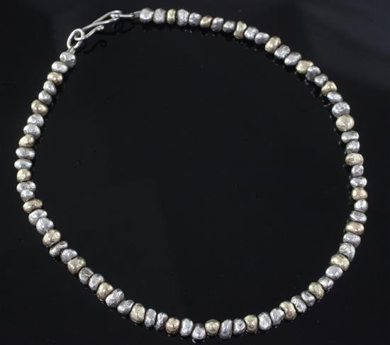 A modern gold and silver nugget necklace by Anton Pruden, Ditchling, 41cm.