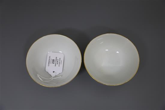 A pair of Chinese yellow ground famille rose bowls, Daoguang six character seal mark and probably of the period (1821-50), Diam.11.5cm
