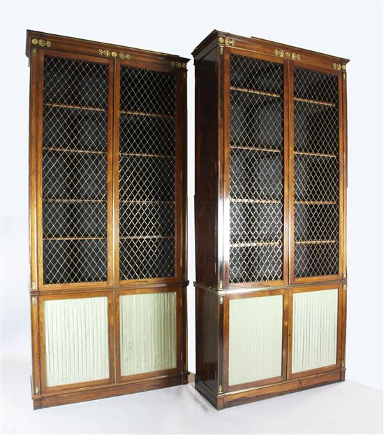 A suite of five Regency rosewood and brass mounted library bookcase cabinets, overall W.25ft 4in. approx.