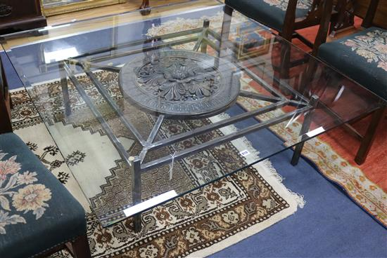 A modern wrought iron coffee table with glass top W.130cm