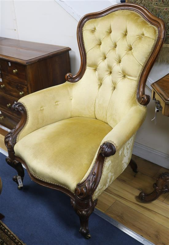 A Victorian mahogany buttonback armchair, upholstered in gold velvet