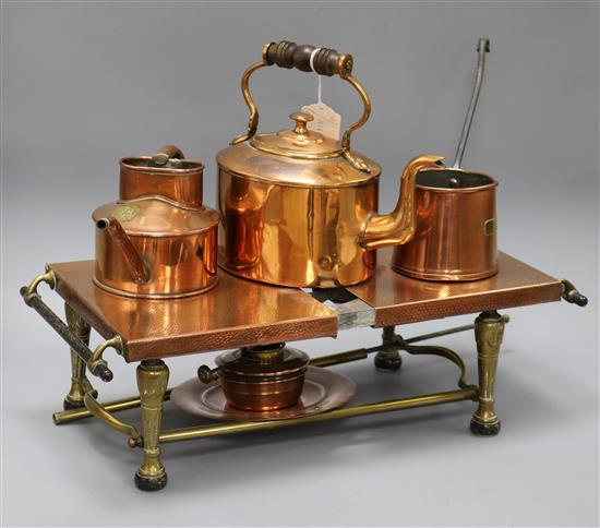 A copper warming stand and copper vessels