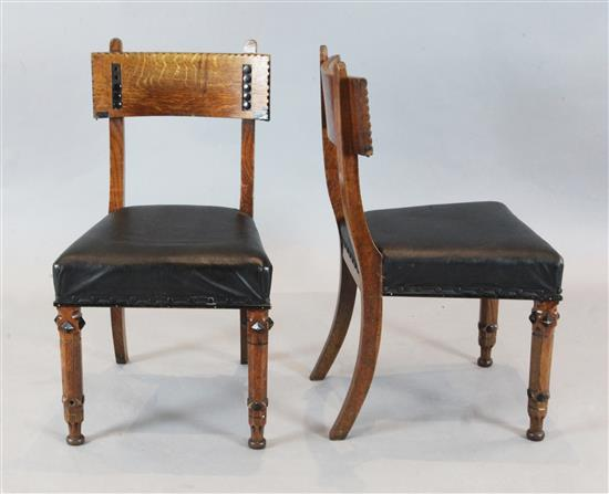 A set of four Victorian oak and ebonised dining chairs, manner of J.P. Seddon