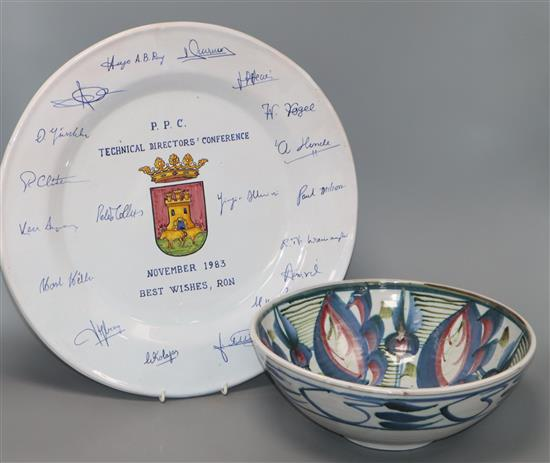 A pottery bowl decorated with stylised flowers in pink, blue and green (signed to base) and a large Talavera presentation charger