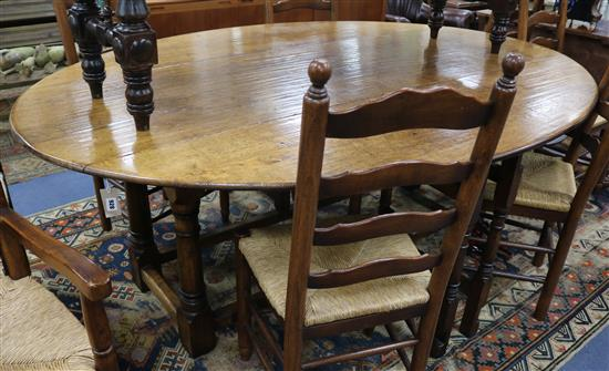 A 17th century style oak double gateleg table W.210cm.