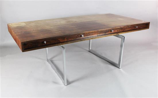 A Bodil Kjær rosewood freestanding working table desk with underframe of chromed steel W.6ft 7in. D.3ft 3in. H.2ft 3in.