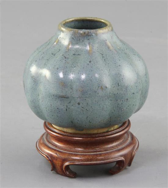 A Chinese Jun-type lobed ovoid vase, 17th/18th century, height 6cm, wood stand