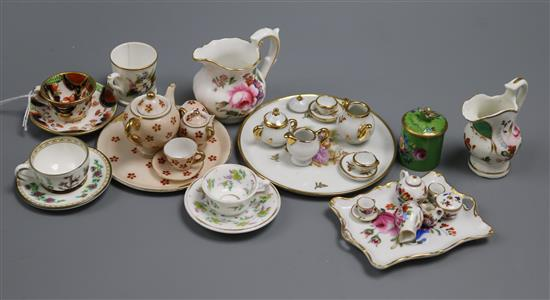 A group of miniature china including teasets, cup and saucers, jugs, etc.