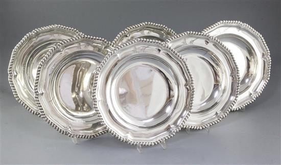 A rare and good set of six George IV silver soup plates, by Paul Storr, Diameter 245mm Total weight 108.5oz/3375grms
