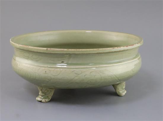 A Chinese Ming Longquan celadon tripod censer, 16th century, D. 27cm, hairline cracks