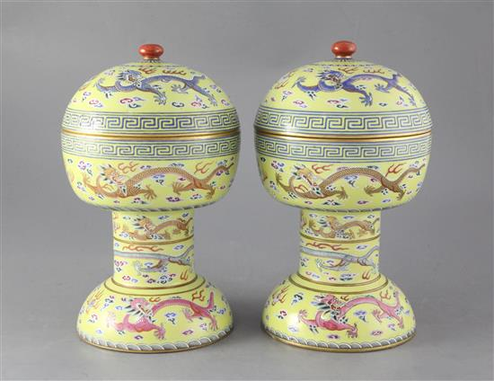 A pair of Chinese yellow ground altar vessels and covers, dou, iron red Daoguang seal marks and of the period (1821-50), height 27.5cm,