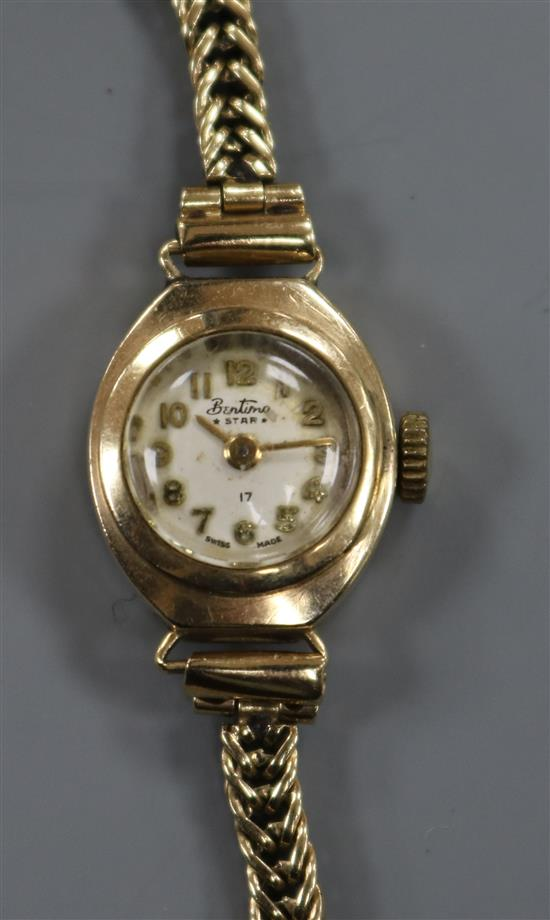 A ladys 9ct gold Bentimo manual wind wrist watch on a 9ct gold bracelet.