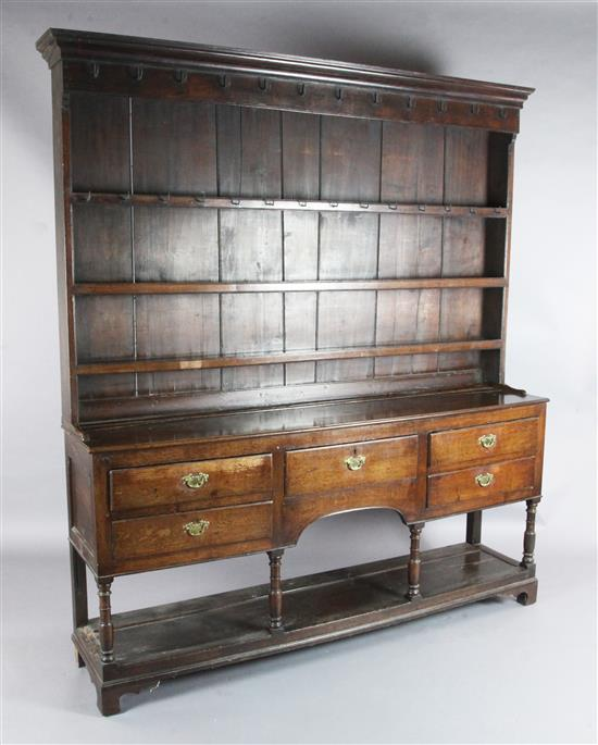 A George III oak dresser, W.6ft 3in. D.1ft 3in. H.6ft 10in.
