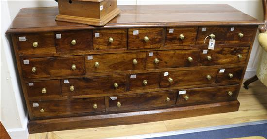 A shop counter of nineteen drawers W.162cm