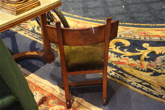 A Reformed Gothic oak dining chair, designed by Edward Welby Pugin, c.1864,