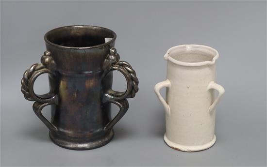 An unusual Dicker ware black lustre three handled tyg and a similar three handled tin glazed pot tallest 18cm
