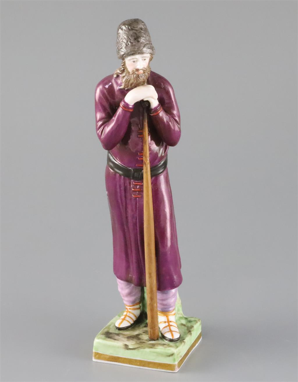 A Russian Gardner porcelain figure of a man holding a staff, mid 19th century, H.21.4cm, loss to left hand and replacement staff