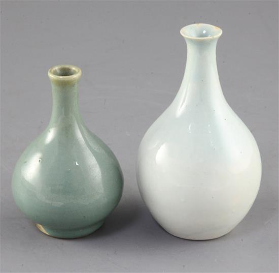 A Chinese Qingbai style bottle vase and a small Jun type green glazed bottle vase, possibly 17th / 18th century, height 11.7cm and 9.7