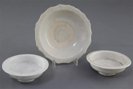 Two similar Qingbai small dishes or cup stands, Song dynasty, and a Qingbai type cup stand, Song / Yuan dynasty, 9cm and 13.3cm