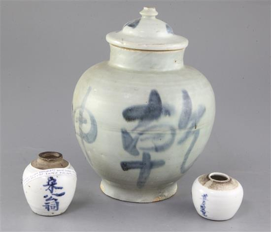 A Chinese blue and white calligraphic jar and cover, and two similar smaller jarlets