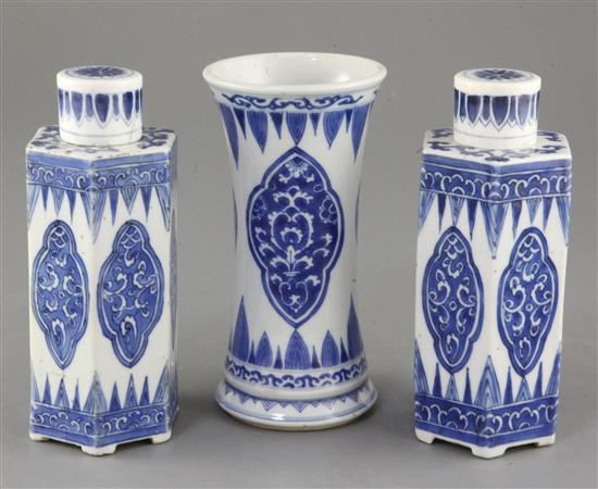 A pair of Chinese blue and white hexagonal jars and covers and a similar beaker vase