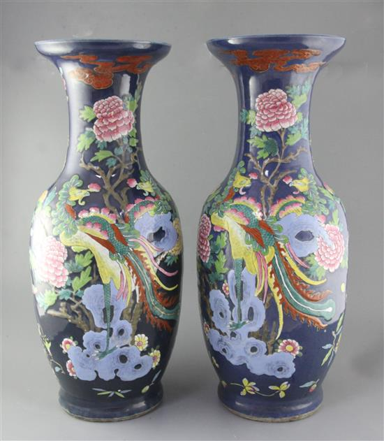 A pair of large Chinese blue ground dragon and phoenix vases, 19th century, restorations