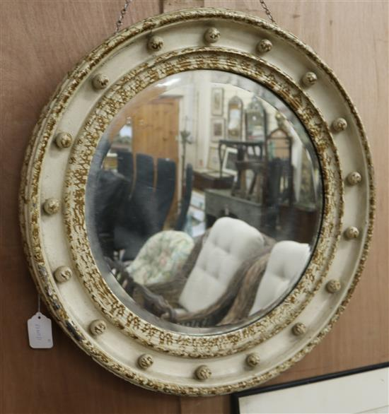 A painted circular wall mirror and a pub mirror circular W.62cm pub W.51cm