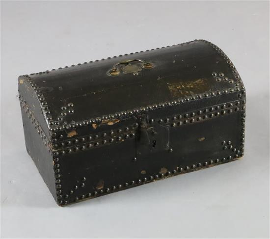 An 18th century small domed topped leather trunk, W.17.5in. D.10in. H.9in.
