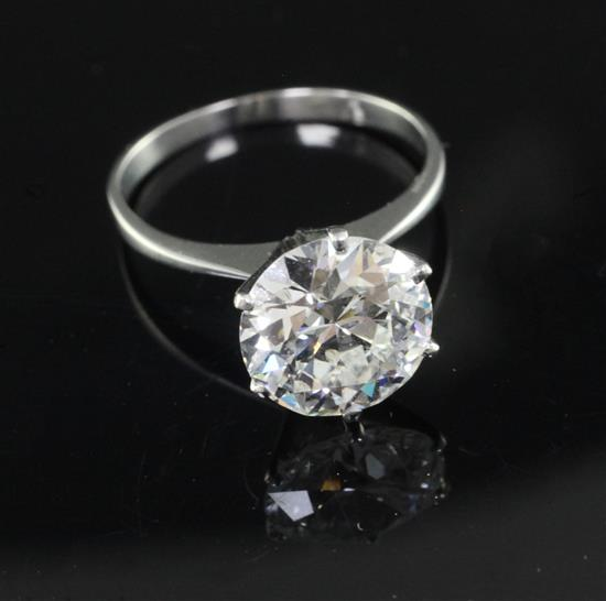A platinum and solitaire diamond ring