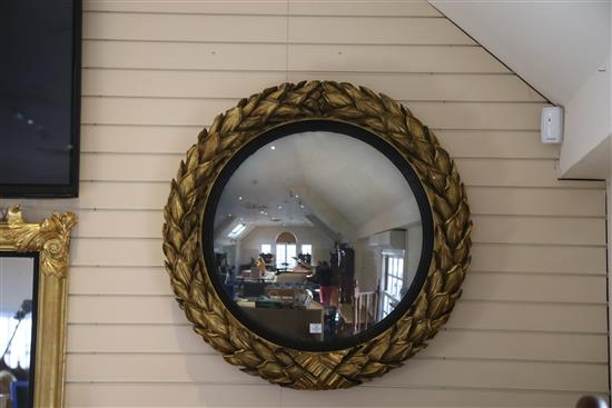 A fine large Regency giltwood and gesso convex wall mirror, Diam.3ft 6in.