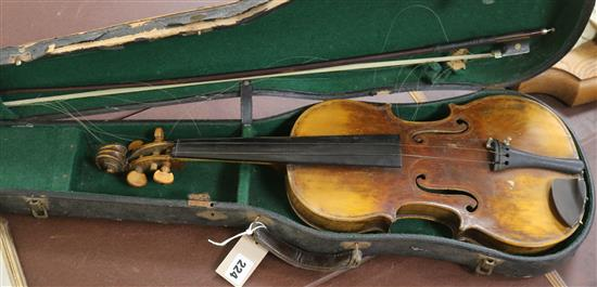 A full sized cased violin with bow