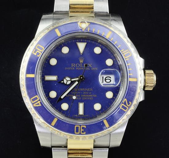 A gentlemens stainless steel and yellow gold Rolex Oyster Perpetual Date Submariner wrist watch,