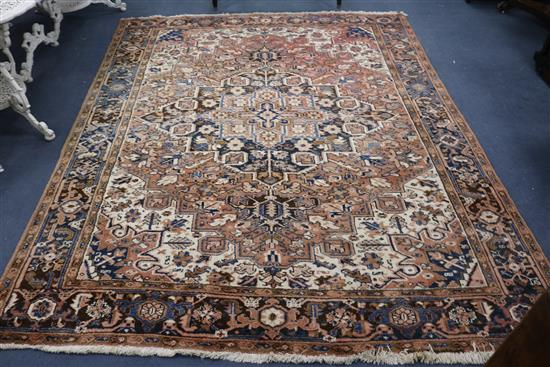 A Persian Kashan cream ground carpet 294 x 234cm