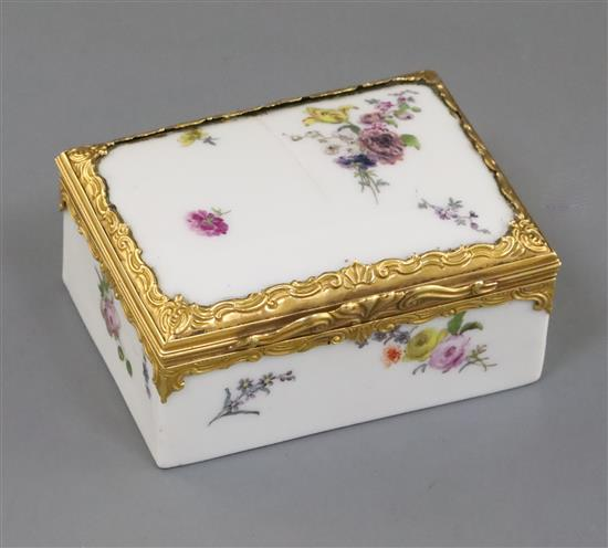 A Meissen gold mounted table snuff box, mid 18th century, W. 6.8cm, lid cracked