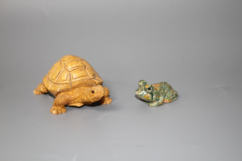 A carved fossil stone tortoise, 8cm and a carved Rhiolite carving of a frog, 4cm