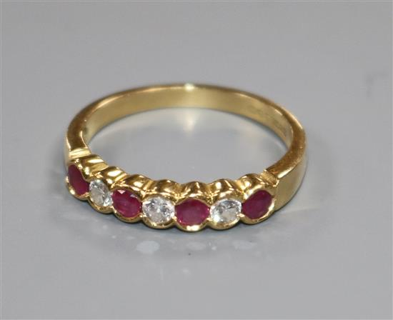 An 18ct yellow gold, ruby and diamond seven-stone ring, collet-set size P/Q.